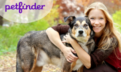 Woman hugging her dog - petfinder logo in upper right corner