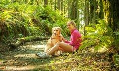 Woman and her dog outdoors on a hike