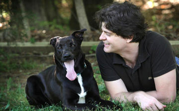 Dr. Brian Hare and a black and white dog